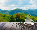 Cup with coffee on table over mountains Royalty Free Stock Photo
