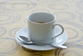 Cup of coffee on tablecloth Royalty Free Stock Photography