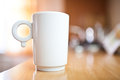 Cup of coffee or tea on wooden table small dof Royalty Free Stock Photography