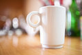 Cup of coffee or tea on wooden table small dof Stock Photo