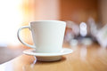 Cup of coffee or tea on wooden table small dof Stock Images