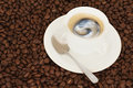 Cup of coffee with teaspoon Royalty Free Stock Photos