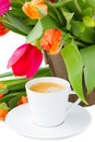Cup of coffee with tulips Royalty Free Stock Image