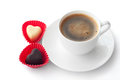 Cup of coffee and two heart-shaped chocolates Royalty Free Stock Photo
