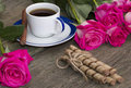 Cup of coffee and from two parties red roses a still life a subject the image flowers Royalty Free Stock Photo