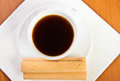 Cup of coffee with waffle puff. Royalty Free Stock Photos