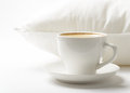 Cup of coffee and white pillow Stock Photography