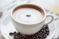 Cup of coffee on white table cappucino Royalty Free Stock Photo