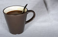 Cup of coffee on the white table cloth Royalty Free Stock Images