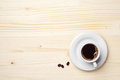 Cup of coffee on wooden background with place for text Stock Photography