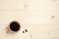 Cup of coffee on wooden background with place for text Stock Images