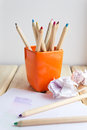 Cup with colorful Pencils on wooden table Royalty Free Stock Photo