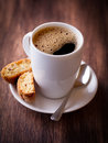 Cup of delicious coffee and cantuccini Stock Images