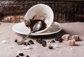 Cup of drunk coffee with ground on table with crumbs and beans Royalty Free Stock Image