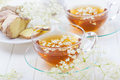 Cup of elder flower tea with ginger Royalty Free Stock Photo