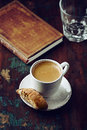 Cup of espresso with cantuccini book and a glass water Royalty Free Stock Photos