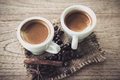 A cup of espresso on grunge wooden background Stock Image