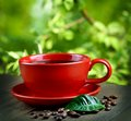 Cup of fresh coffee with leaf Royalty Free Stock Photo