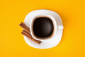 Cup of fresh espresso on yellow background, view from above Royalty Free Stock Photo
