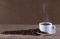 Cup fresh hot steaming coffee burlap surface Royalty Free Stock Photo