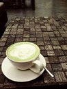 A cup of green tea on the brown block table Royalty Free Stock Photos