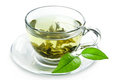 Cup with green tea and green leaves. Royalty Free Stock Photo