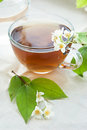 Cup of green tea with jasmine Stock Photo