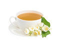 Cup of green tea with jasmine flowers isolated on white backgrou Royalty Free Stock Photo