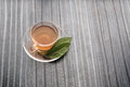 A cup of Green tea and leafs on wood talbe Royalty Free Stock Photo