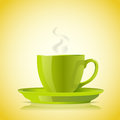 Cup of green tea on yellow background Royalty Free Stock Photos