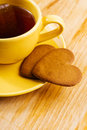 Cup and heart shaped cookies yellow with tea bag Stock Photos