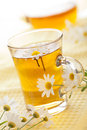 Cup of herbal tea with chamomile flowers Stock Photo