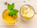 Cup of herbal tea with fresh green mint ,honey and lemon on wood Royalty Free Stock Photo