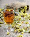 Cup of herbal tea and honey. medicinal herbs. close-up. remedy for flu and cold Royalty Free Stock Photo