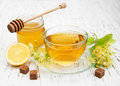 Cup of herbal tea with linden flowers on a old wooden background Royalty Free Stock Image