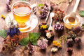 Cup of herbal tea with wild flowers and various herbs Royalty Free Stock Photo