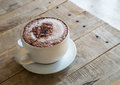 Cup of hot cofee on wooden table Royalty Free Stock Photo
