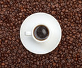 Cup with Hot Coffee on Coffee Beans Royalty Free Stock Photos