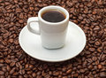 Cup with Hot Coffee on Coffee Beans Royalty Free Stock Images