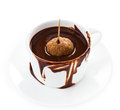Cup of hot dark chocolate cocoa flow isolated on white background cl with a candy stick close up Stock Image