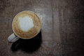 A cup of hot latte cappuccino on old metal surface Royalty Free Stock Photo