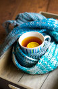 Cup of hot tea in the cold time winter with lemon and scarf Royalty Free Stock Photos