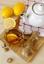 Cup of hot tea with a lemon and ginger Royalty Free Stock Photo