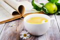 Cup of herbal tea and old book Royalty Free Stock Photo