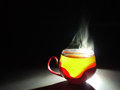 Cup of hot tea with swan like steam Royalty Free Stock Photography