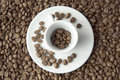 CUP OF JAMAICA BLUE MOUNTAIN COFFEE ROASTED BEANS DARK BACKGROUND AND TEXTURE TOP VIEW CLOSE UP CONCEPT Royalty Free Stock Photo