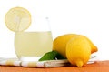 Cup of lemon juice and fresh lemons as a background Stock Photos