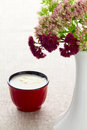 A cup of milk and bouquet autumn flowers in vase Stock Images