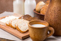 Cup of milk with bread for a healthy breakfast Royalty Free Stock Photo