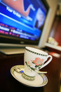 Cup with monitor show chart Stock Photo
